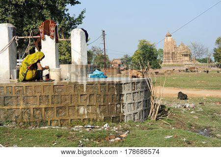 Woman Taking Water From The Waterhole