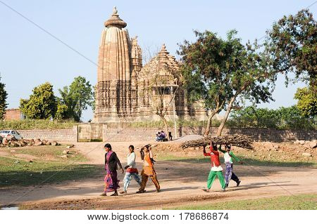People Walking In Front Of Khajuraho Temple