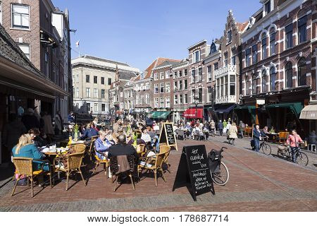 utrecht netherlands 15 march 2017: people enjoy sunny day in early spring on open air cafe at vismarkt in the dutch city of utrecht