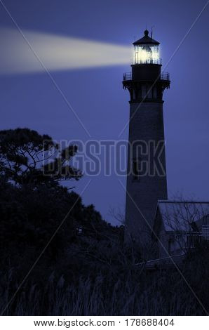 A lighthouse lit up during the night