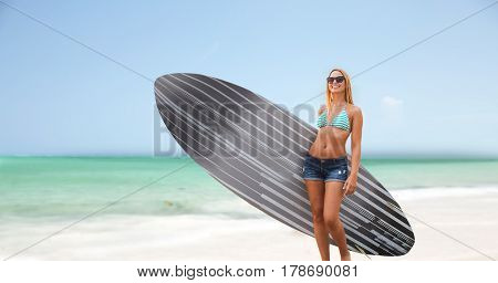 sea, summer vacation, water sport and people concept - smiling young woman with surfboard on beach