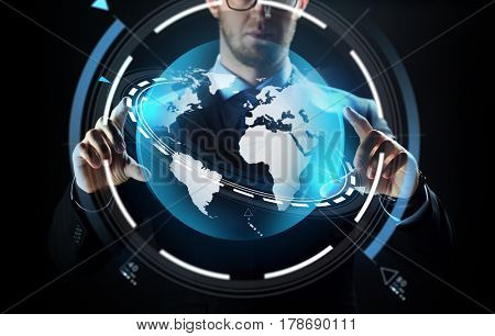 business, people, technology and cyberspace concept - close up of businessman in suit working with earth projection over black background