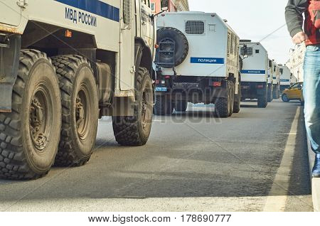Moscow - march 26 2017. Forbidden political meeting against corruption. Column of police trucks for arresting people driving along Tverskaya street