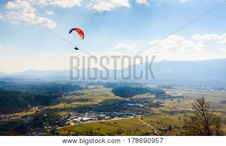 Paraglider Is Flying In The Valley.