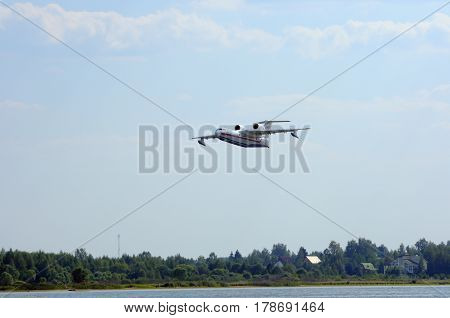 VOLGA RIVER KONAKOVO RUSSIA - JULY 31: Russian amphibious aircraft (flying boat) BE-200 designed for the Russian Emergencies Ministry. Preparing for the abstraction of water from the river to extinguish a forest fire.