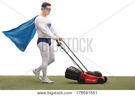 Full length profile shot of a superhero mowing with a lawnmower isolated on white background