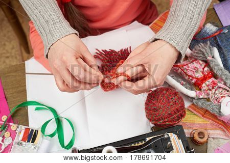 mother teaching daughter girl knit, top view, sewing accessories top view, seamstress workplace, many object for needlework, handmade and handicraft