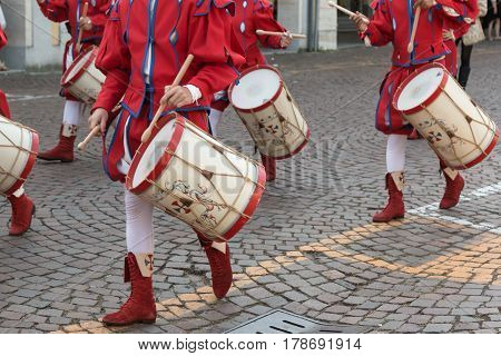 Drummers in Red and White Uniform Playing Snare Drums in Parade
