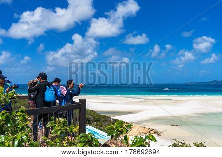 Whitsunday Australia - February 5 2017: People on Hill Inlet lookout observation platform with view of Hill Inlet estuary and Whitehaven Beach. Whitsundays Queensland Australia