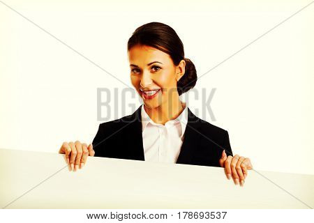 Businesswoman holding white banner