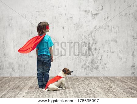 Little superhero with dog