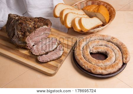 Roasted Traditional Homemade Sausage With Spices And Herbs. Baked Pork With Herbs And Spice On Woode