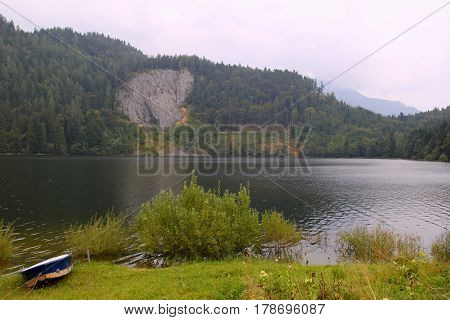 Travel To Sankt-wolfgang, Austria. The View On The On The Mountains Lake With The Blue-white Boat On