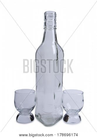 Empty glasses bottles on white background