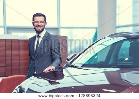 Smiling businessman in showroom