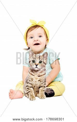 Cute little girl sitting with kitten Scottish Straight, isolated on white background