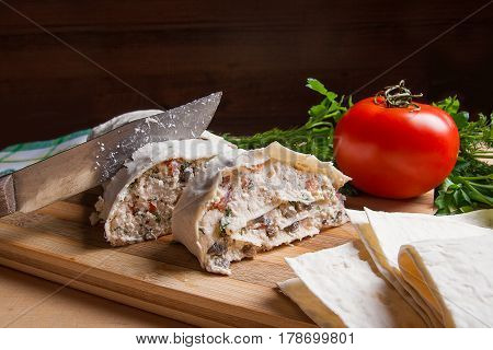 Pieces Of Cutted Pita Bread Or Lavash Roll With Cottage Cheese Or Curd, Chicken, Tomatoes And Herbs