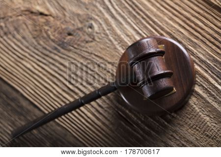 Law and justice concept - gavel of judge  on wooden table.