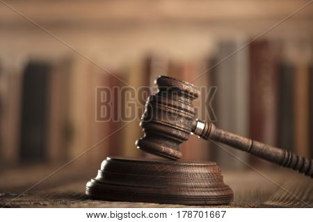 Law theme, gavel of judge and legal code on wooden table