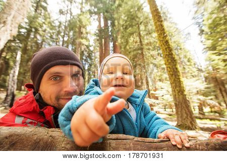 Father With Infant Son Visit Sequoia National Park In California, Usa