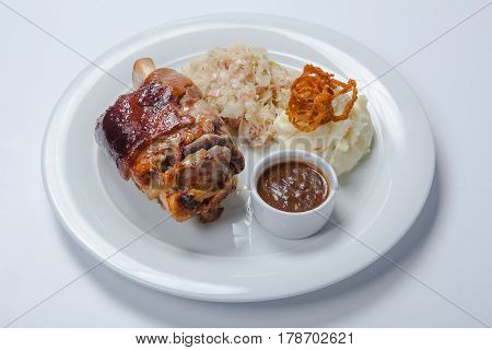 Baked Pork Knuckle Served With Braised Cabbage
