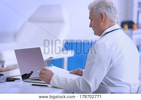 Male doctor at work in clinic