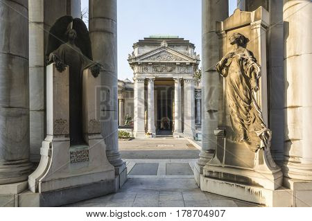 BOLOGNA,ITALY-DECEMBER 7,2016:Angels inside monumental cemetery of the Certosa in Bologna during a sunny day.