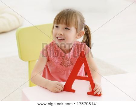 Cute little girl at speech therapist office