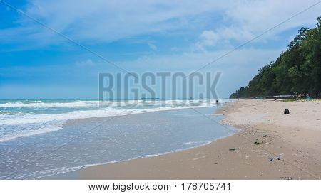 Unidentified person collecting rubbish along the beach in the moring at Mae Rumphueng Beach , Rayong , Thailand
