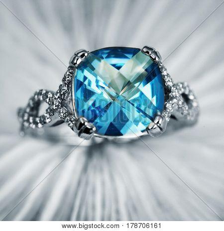 Elegant jewelry ring with jewel blue topaz and diamonds