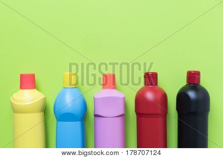 House cleaning product on green background, top view