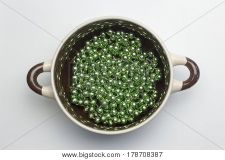 Many decorative balls on the bottom of the soup tureen on white background.