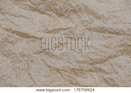 Wrinkled kraft paper. Top view brown crumpled paper background texture.