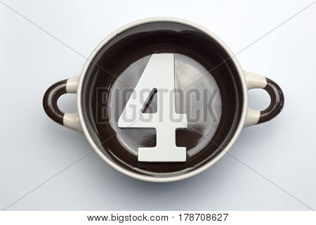 Figure four on the bottom of the soup tureen on white background.