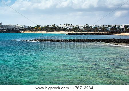 Turquoise waters and sandy coast in Playa Las Cucharas beach in Costa Teguise Lanzarote Canary islands selective focus