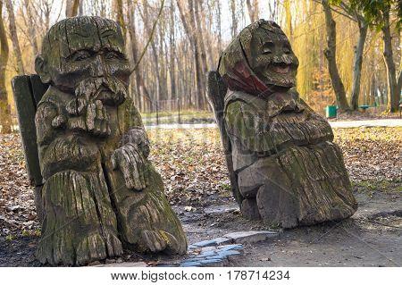 wooden sculptures grandfather grandmother art object park