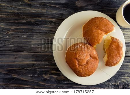 Berliner donuts on a wooden table in rustic style