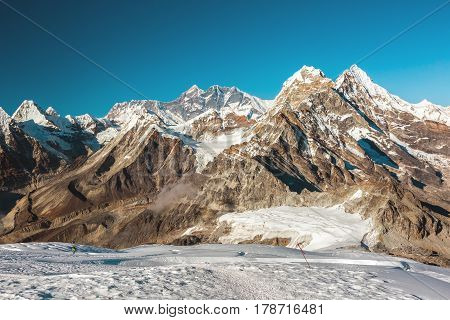 View of Central Himalaya Peaks Glacier with deep eternal Snow and majestic Peaks on Background