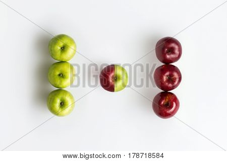 Top view of genetically modified red and green apples isolated over white