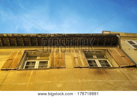 Detail of windows with yellow shutters in the city center of the Perpignan in southeastern France
