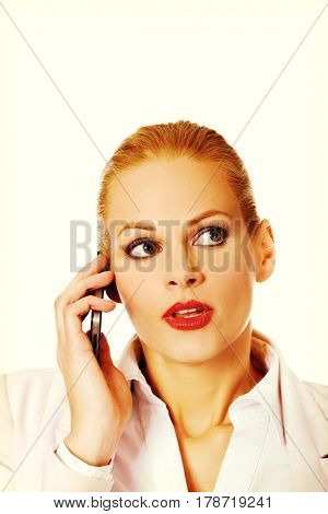Serious business woman talking through a mobile phone