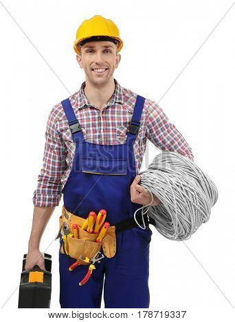 Young electrician with tools and wires on white background