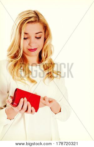 Young woman with empty pocket, on white.
