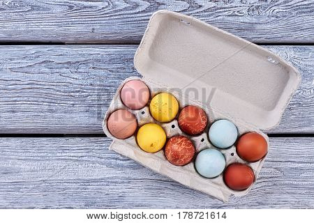 Easter egg tray, wood background. Top view of chicken eggs.