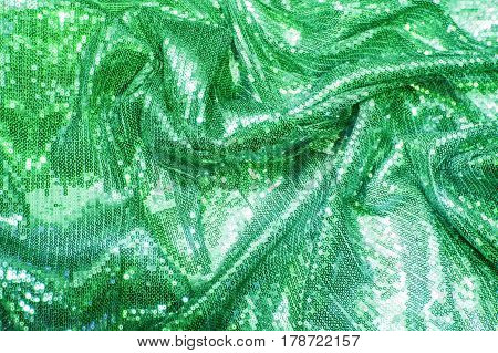 Colorful, luxurious green, emerald, sea wave, sequins background Gold sparkle glitter background