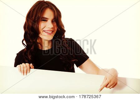Smiling young business woman holding blank signboard