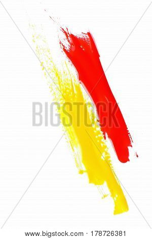 Modern art, abstract painting, bright saturated yellow and red color streaks on white background. Abstractionism, creativity.