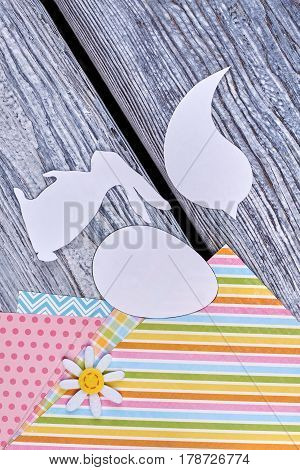 Papercut animalistic silhouettes. Color patterned paper. Easter festive preparations.