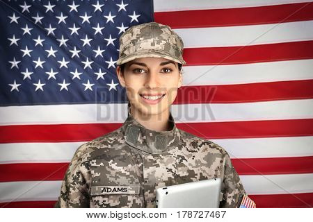 Female soldier with tablet on USA flag background