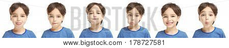 Speech training concept. Little boy doing exercises for correct pronunciation on white background